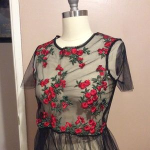 Mesh shirt with rose embroidery detail, and peplum